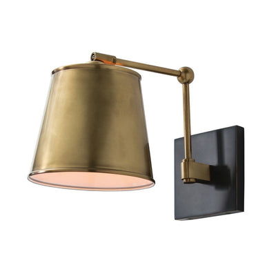 The Polastsk Wall Sconce in an antique brass finish with an adjustable arm.