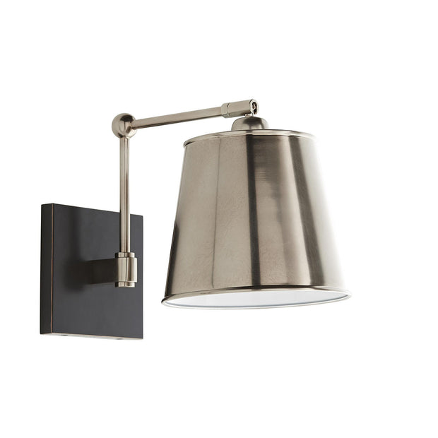 A vintage silver mid-century modern light with a metal drum shade and adjustable arm.