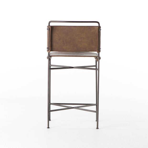 Back view of the Stowe Counter Stool with brown leather seat and backrest and slim steel tubing frame.