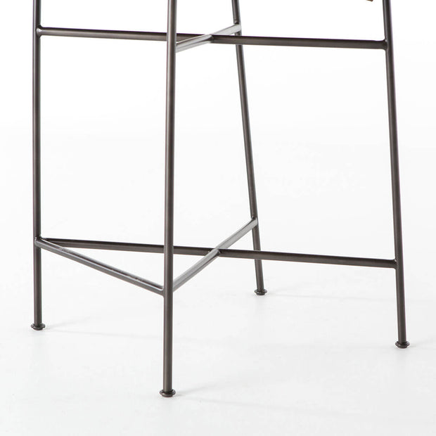Black, steel tubing frame on a modern counter stool.
