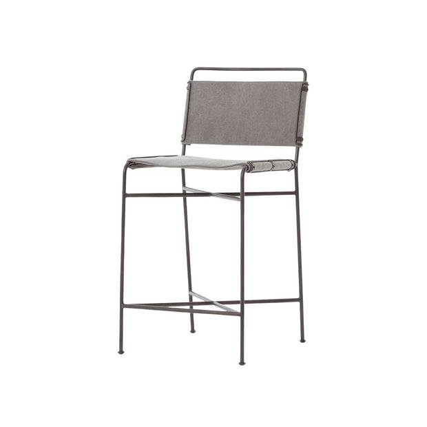 Industrial counter stool with a slim, steel frame and stonewash grey cotton seat and backrest.
