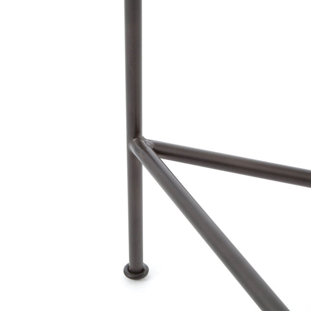 Closeup of the slim, black steel tubing frame.