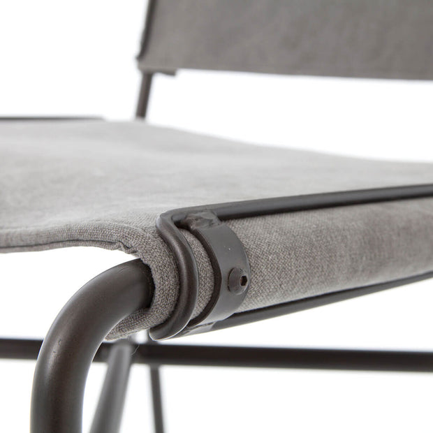 Stonewash grey leather seat and black tube metal details on an industrial counter stool.