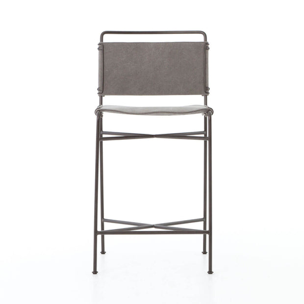 The Stowe Counter Stool has a simple steel tube frame and contoured stonewash grey cotton seat and backrest.