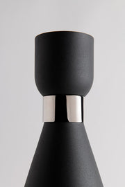 Black coned lamp shade with polished nickel cuff for a modern looking wall sconce.