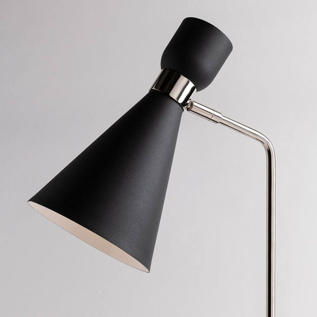Tapered lamp shade and adjustable swivel arm on a black modern wall sconce.
