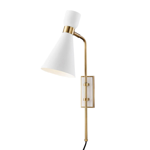 The Hudson Wall Sconce with a white tapered lamp shade and brass cuff details.
