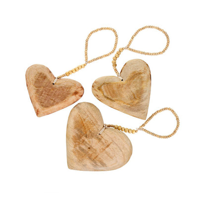 The Wooden Heart Ornament Set is a set of three, rustic heart holiday decorations.