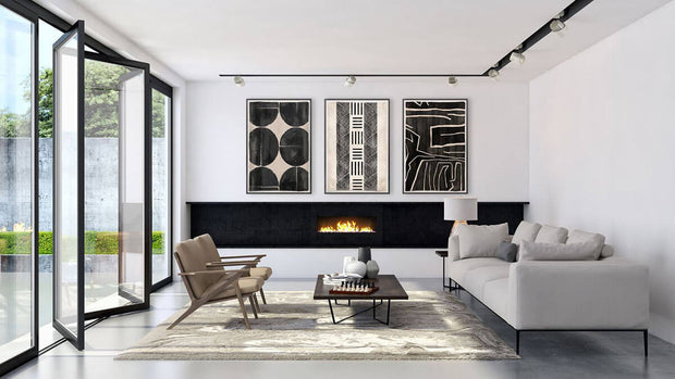Collection of abstract, contemporary mud paintings in a modern living room.