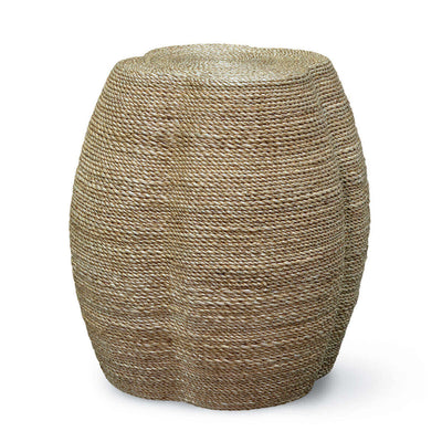 The Minya Side Table is a clover shaped stool with a rattan pole frame wrapped in finely woven, natural abaca rope.