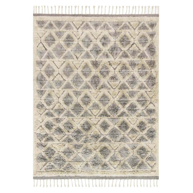 Arendal Smoke / Taupe Rug. Hand loomed taupe and grey rug with a slightly shaggy texture and geometric pattern.
