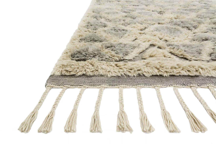 Fringe detail and shaggy texture of the hand loomed, geometric pattern rug.