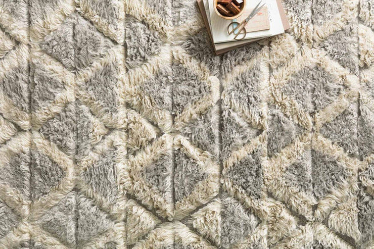 Smoke and taupe shaggy rug that is perfect in high traffic areas.