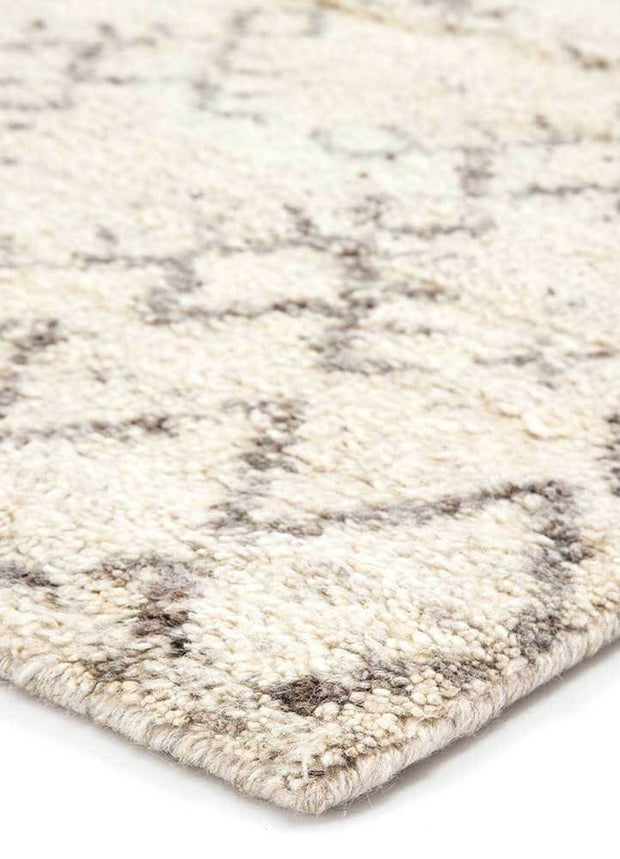 Merzouga Turtledove / Walnut Rug. Distressed pattern rug. Light, neutral rug. Moroccan style rug.