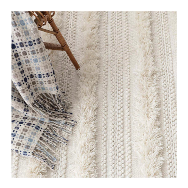 Performance rug with Bohemian, Moroccan style. Eco-friendly polyester fiber made from recycled plastic bottles. Perfect for a variety of indoor and outdoor spaces.