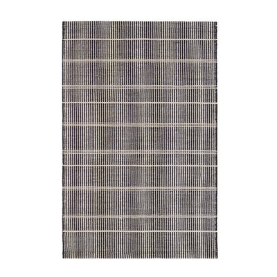 Wool-like, durable, eco-friendly polyester striped black outdoor rug made from recycled bottles.