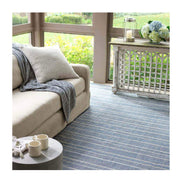 Navy Indoor / Outdoor Rug. Striped blue and white rug for a comfortable seating area on a patio.