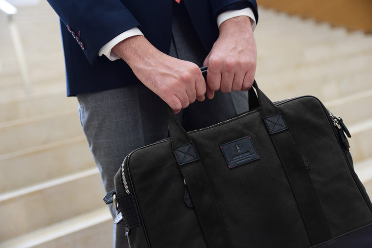 Coined as the workhorse of classic office bags, the Aspen Briefcase in Jet Black is made from full-grained leather, organic canvas and YKK Japan zippers. This briefcase will stand by you through boardroom wars as it would those weekend escapades. Well gla