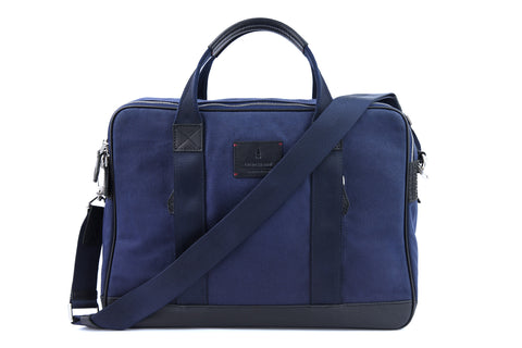 Coined as the workhorse of classic office bags, the Aspen Briefcase in Space Blue is made from full-grained leather, waxed canvas and YKK Japan zippers. This briefcase will stand by you through boardroom wars as it would those weekend escapades. Well gladly, everything in between too, if you must.