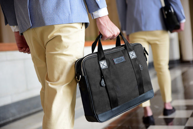 A distinct choice for modern individuals, the Aspen Slim Briefcase in Jet Black is pieced with full-grain leather, organic canvas and YKK Japan zippers. When you hold it in your hand, we imagine it to fuel an inner fire that not only makes you walk differ