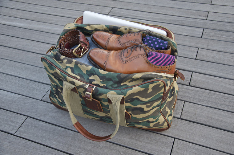 With an eye-catching Camouflage print on the canvas and full-grain leather trimmings, our Balsa Duffel is one to make a bold statement with.