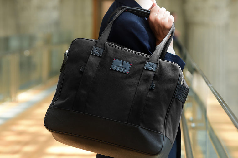 Crafted in full-grain leather, organic canvas and YKK Japan Zippers, the Jet Black Castor Tote boasts a spacious interior and lush leather handles for your toting pleasures. Take it anywhere.