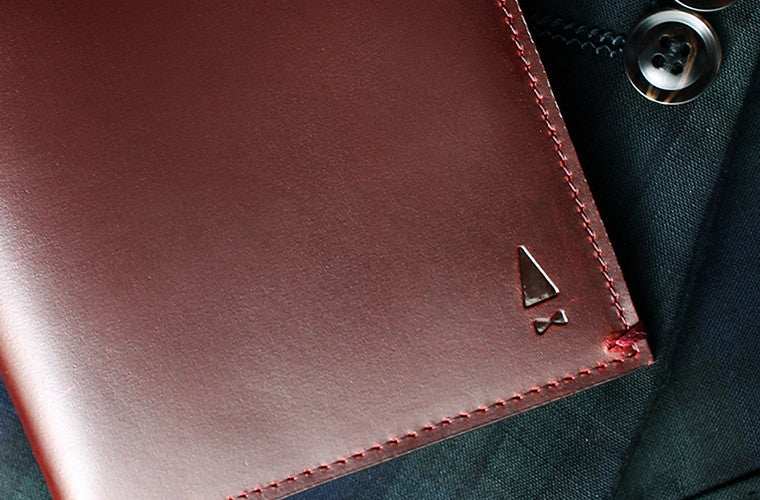 Discreet and sophisticated, the full-grain leather Cloak passport holder in Oxblood holds all your travel essentials in a silhouette that fits your hand like a pair of leather gloves.