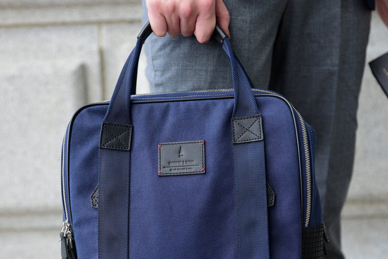 The Kale Backpack in Space Blue is built from full-grain leather, waxed canvas and YKK Japan Zippers. With tech-friendly slots, it is redefined in contemporary proportions and made to conquer every need of the modern maverick.