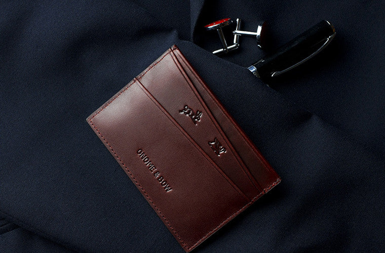 The Elm in Oxblood, is a two sided full-grain leather card sleeve that allows for easy access to your cards, making it a simple alternative to your wallet.