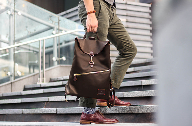 The reversible Clifford Backpack in Forest Green nylon and brown full-grain leather gives you the comfort that keeps you coming back everyday. When reversed, the bag becomes a fuss-free weekend carry that unleashes your personality.