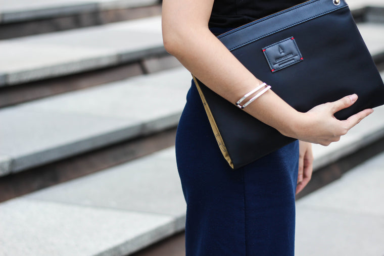 The reversible Milton Clutch in Midnight Blue is detailed with blue full-grain leather trimmings and nylon exterior, combining the minimalist silhouette of a clutch with the timeless versatility of a crossbody bag - perfect for that evening weekend outing