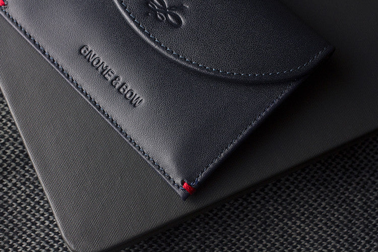 The Leicester Full-grain leather Coin Case in Deep Sea Blue carries both cards and coins with a slim silhouette, making it a classy piece for the distinguished gentleman.