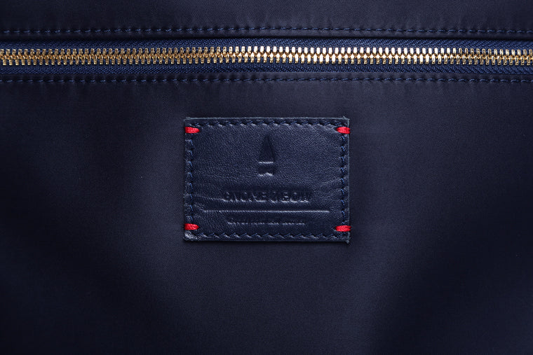 The reversible Strand Briefcase in Midnight Blue is built with nylon and blue full-grain leather accents. Equal parts function and style, an inner rebel emerges for an alternative mood when reversed.