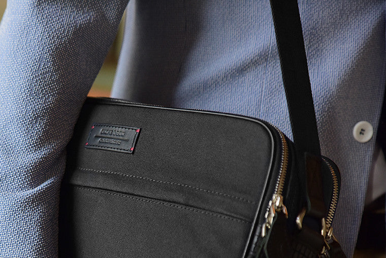 The Thyme is your classic messenger in Jet Black, contrived from full-grain leather, organic canvas, YKK Japan zippers and tech-friendly slots. While holding all your essentials in a compact profile, it speaks volumes through understated detailing and fin