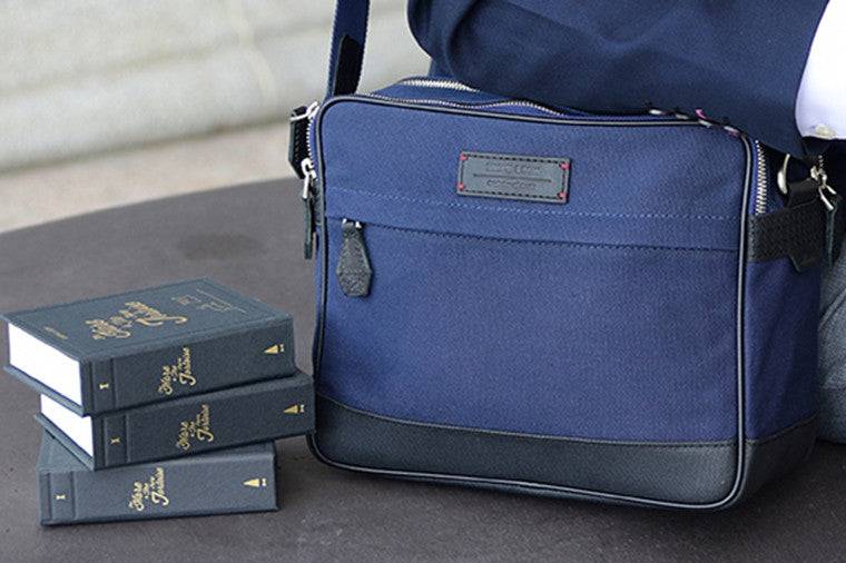 The Thyme Small Messenger in Space Blue is built from full-grain leather, waxed canvas and YKK Japan zippers. With tech-friendly slots, it's your trusty companion for world travels and daily commutes.