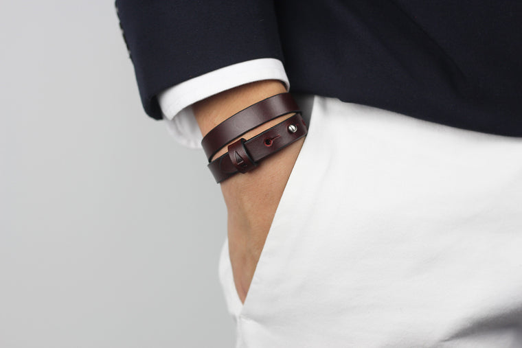 The Double Twine full-grain leather bracelet in Oxblood takes on a robust character when worn, constantly changing its form and bringing about an effortless charm.