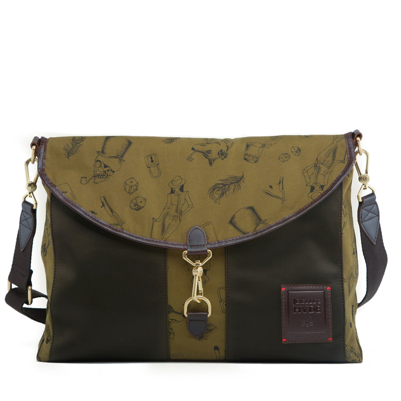 9928a5613f The reversible Kensington Messenger in Forest Green is pieced from nylon  and brown full-grain