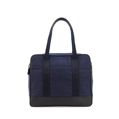 Crafted in full-grain leather, waxed canvas and YKK Japan Zippers, the Space Blue Castor Tote boasts a spacious interior and lush leather handles for your toting pleasures. Take it anywhere.