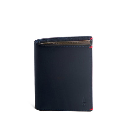 The Brighton Card Wallet exudes a Deep Sea Blue full-grain leather hue on the outside with a deep shade of green on the inside. Designed with a streamlined portrait aesthetic, its ideal for the urban gentleman who is inclined towards minimalism but is always prepared.