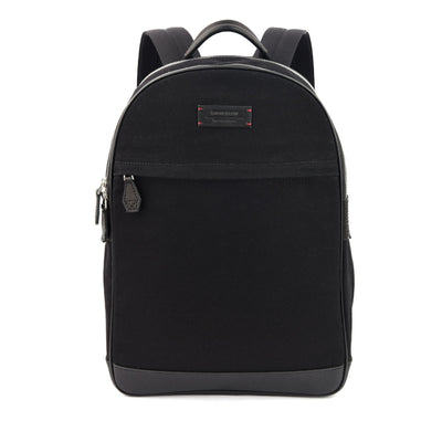 The Kale Backpack in Jet Black is built from full-grain leather, organic canvas and YKK Japan Zippers. With tech-friendly slots, it is redefined in contemporary proportions and made to conquer every need of the modern maverick.