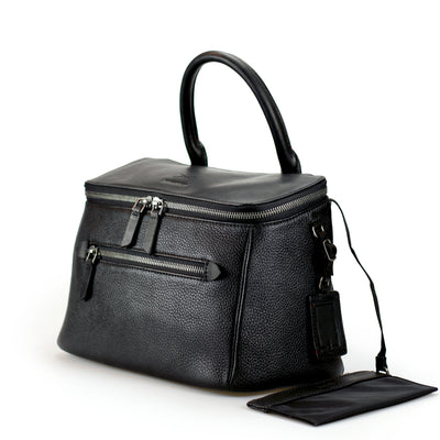 The D'ryna leather handbag commands a presence with its unique trapezium structure, a amalgamation of style meets function. Limited Quantities.