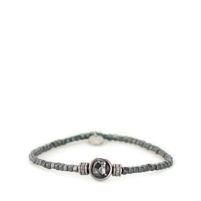 The harmonious coupling of a lucky horse antique silver charm with the organic form of hematite cubes makes for a bracelet that's effortlessly stylish and versatile.