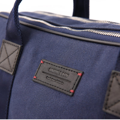 A distinct choice for modern individuals, the Aspen Slim Briefcase in Space Blue is pieced with full-grain leather, waxed canvas and YKK Japan zippers. When you hold it in your hand, we imagine it to fuel an inner fire that not only makes you walk different, but think different.
