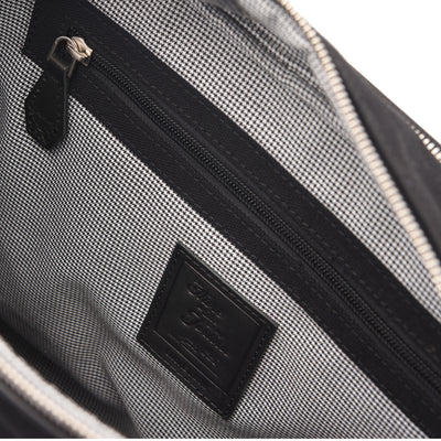 The Thyme is your classic messenger in Jet Black, contrived from full-grain leather, organic canvas, YKK Japan zippers and tech-friendly slots. While holding all your essentials in a compact profile, it speaks volumes through understated detailing and finishing.