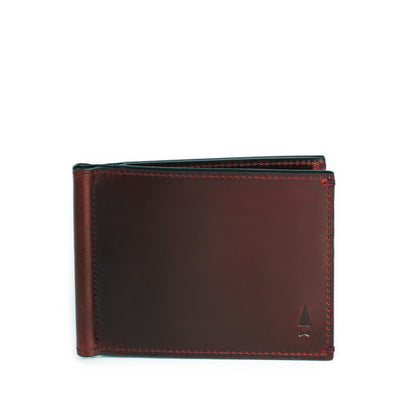 Regardless of cash or cards, the Regal full-grain leather money clip wallet in Oxblood embraces them all, exuding a panache that speaks of your confidence in taste.