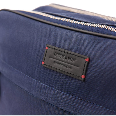 The Thyme is your classic messenger in Space Blue, contrived of full-grain leather, waxed canvas, YKK Japan zippers and tech-friendly slots. While holding all your essentials in a compact profile, it speaks volumes through understated detailing and finishing.