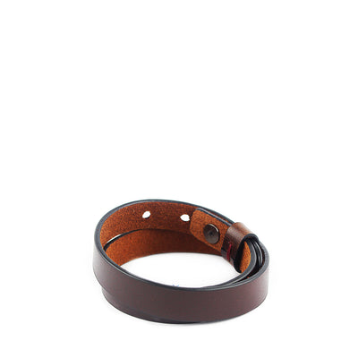 Assuming an understated yet elegant form, the Twine Single Bracelet in Mahogany accents your wrist with our lush full-grain leathers for that extra level of attention to detail.