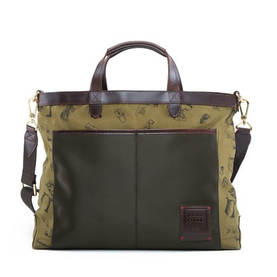 The reversible Strand Briefcase in Olive Maverick is built with canvas and brown full-grain leather accents. Equal parts function and style, a sophisticated side emerges when reversed.