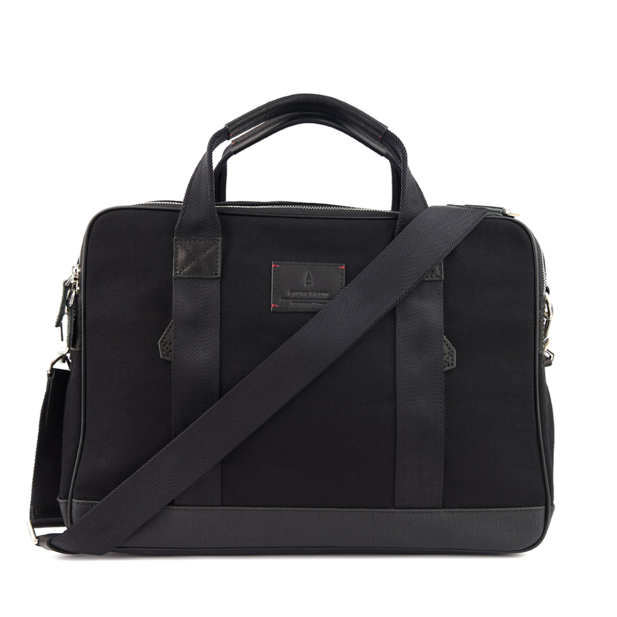 Coined as the workhorse of classic office bags, the Aspen Briefcase in Jet Black is made from full-grained leather, organic canvas and YKK Japan zippers. This briefcase will stand by you through boardroom wars as it would those weekend escapades. Well gladly, everything in between too, if you must.