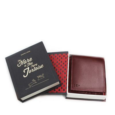 The full-grain leather Linden Billfold in Oxblood, featuring card sleeves and checked compartment lining, is the contemporary accessory for the man who loves the classics but also appreciates a modern twist.
